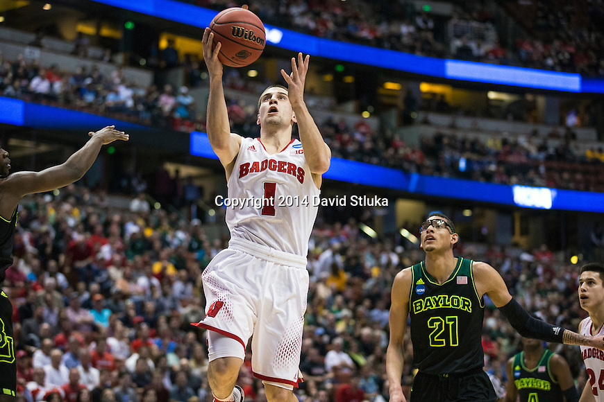 Wisconsin Badgers guard Ben Brust (1) shoots a layup during the fourth-round game in the NCAA college basketball tournament against the Baylor Bears Thursday, March 27, 2014 in Anaheim, California. The Badgers won 69-52. (Photo by David Stluka)