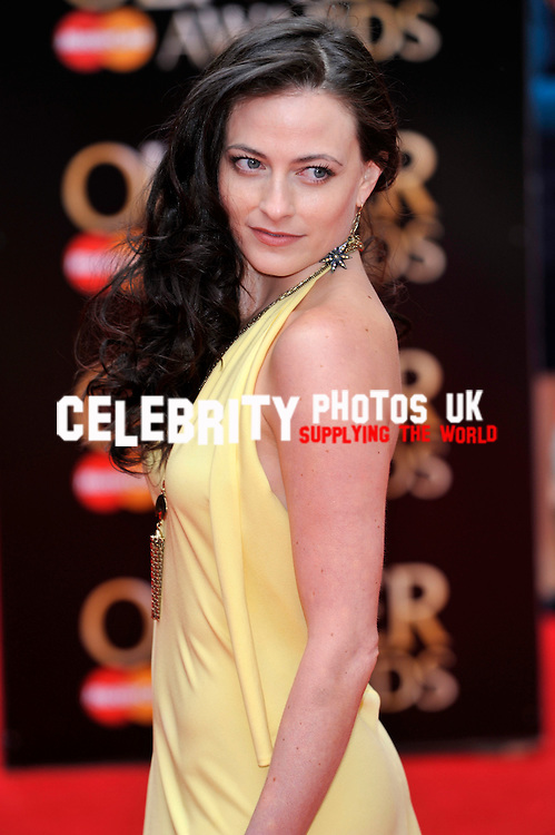 Lara Pulver   attends The Laurence Olivier Awards at the Royal Opera House on April 28, 2013 in London Picture By: Brian Jordan / Retna Pictures.. ..-..