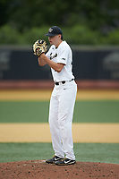 Wake Forest Demon Deacons starting pitcher Ryan Cusick (33) looks to his catcher for the sign against the Davidson Wildcats at David F. Couch Ballpark on May 7, 2019 in  Winston-Salem, North Carolina. The Demon Deacons defeated the Wildcats 11-8. (Brian Westerholt/Four Seam Images)