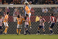 Chivas goalkeeper Dan Kennedy goes high to save a ball from Houston's Nate Jaqua.  The Houston Dynamo and Chivas USA played to a 1-1 tie at Home Depot Center stadium in Carson, California on Saturday October 25, 2008. Photo by Michael Janosz/isiphotos.com
