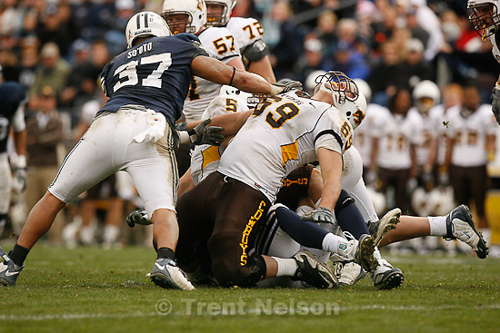 Trent Nelson  |  The Salt Lake Tribune.BYU defensive lineman Vic So'oto (37) pushes over Wyoming's John Hutchins during the second half, BYU vs. Wyoming, college football Saturday, October 23, 2010 at LaVell Edwards Stadium in Provo. BYU won 25-20.