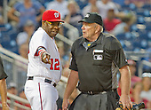 Washington Nationals manager Dusty Baker (12) argues with umpire Bob Davidson (61) after Davidson ejected Anthony Rendon for arguing strikes in the twelfth inning against the Washington Nationals at Nationals Park in Washington, D.C. on Wednesday, June 15, 2016.  The Nationals won the game 5 - 4 in 12 innings.<br /> Credit: Ron Sachs / CNP