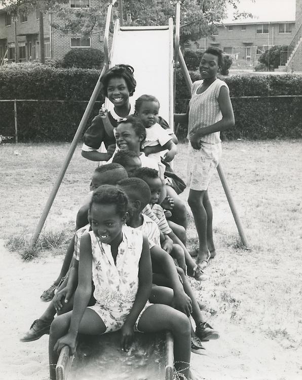1967 June 12..Historical..Kids on sliding board..Sam McKay.NEG# SLM 67-34-6.NRHA# 4125..