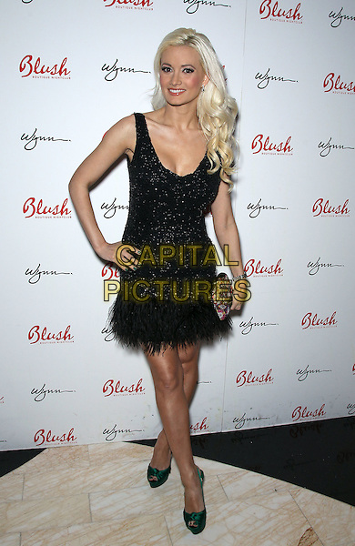 Holly Madison.Holly Madison hosts the 4th Anniversary of Blush Boutique Nightclub inside the Wynn , Las Vegas, NV., USA..September 3rd, 2011.full length black dress sleeveless sparkly  feather green shoes hand on hip clutch bag roulette .CAP/ADM/MJT.© MJT/AdMedia/Capital Pictures.