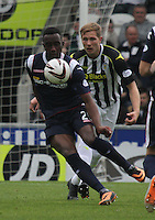 Jordan Slew shielding the ball from Marc McAusland in the St Mirren v Ross County Scottish Professional Football League Premiership match played at St Mirren Park, Paisley on 3.5.14.