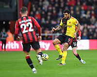 Troy Deeney of Watford holds the ball up ahead of Harry Wilson of Bournemouth and Adam Smith of Bournemouth  during AFC Bournemouth vs Watford, Premier League Football at the Vitality Stadium on 12th January 2020