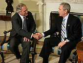 "Washington, D.C. - May 5, 2005 -- Central Intelligence Agency (CIA) Director Porter Goss (L) and United States President George W. Bush shake hands in the Oval Office during an announcement  that Goss is resigning as director of the CIA May 5, 2006 in Washington, DC. Bush said that he appreciated Goss' ""candid advice"" during his two years as director of the CIA.<br /> Credit: Chip Somodevilla - Pool via CNP"