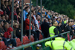 The New Saints 4 Bohemians 0, 20/07/2010. Park Hall Stadium, Champions League 2nd qualifying round 2nd leg. Supporters of Irish club Bohemians watching the action at Park Hall Stadium, Oswestry during their team's Champions League 2nd qualifying round 2nd leg game away to The New Saints. Despite leading 1-0 from the first leg, the Dublin club went out following their 4-0 defeat by the Welsh champions. The match was the first-ever Champions League match in the UK played on an artificial pitch and was staged at the Welsh Premier League's ground which was located over the border in England. Photo by Colin McPherson.
