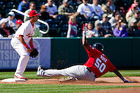 Jose Ruiz (50) of the Frisco RoughRiders slides into third base during a game against the Springfield Cardinals on April 16, 2011 at Hammons Field in Springfield, Missouri.  Photo By David Welker/Four Seam Images.