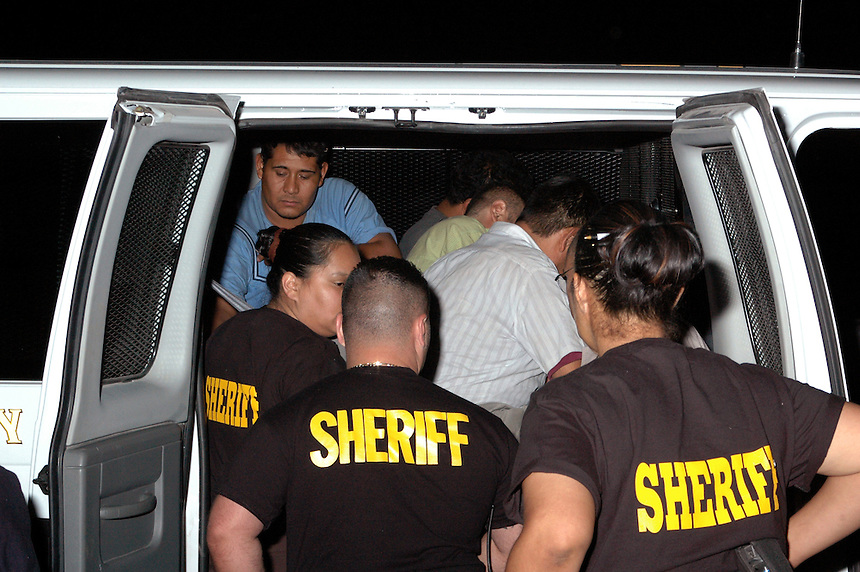 AJ Alexnader - Illeagals Arrested and loaded up in a van by the Maricopa Sheriff's Office..Photo by AJ Alexander