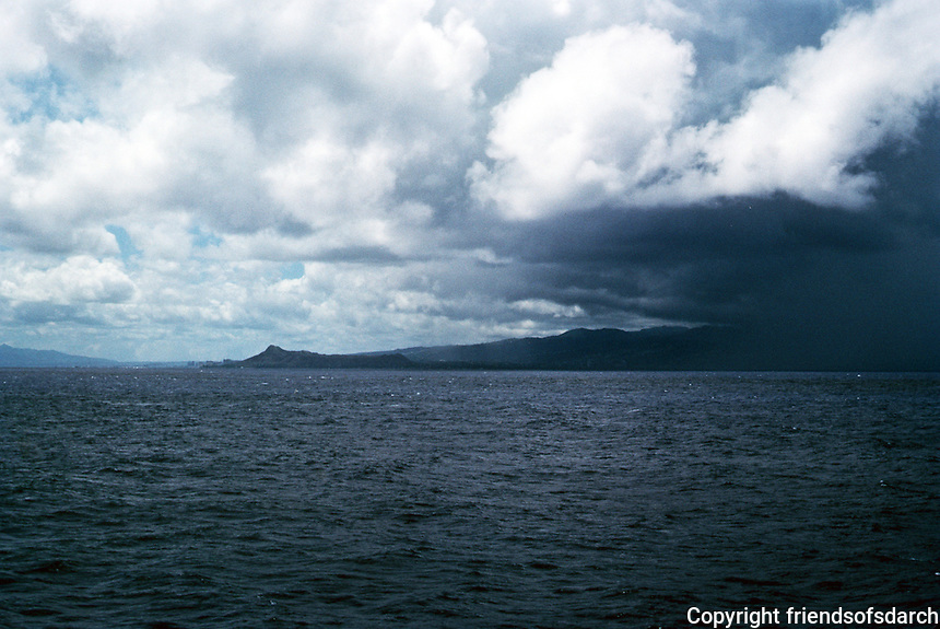 Honolulu: Oahu under clouds. View from ship. Photo '82.