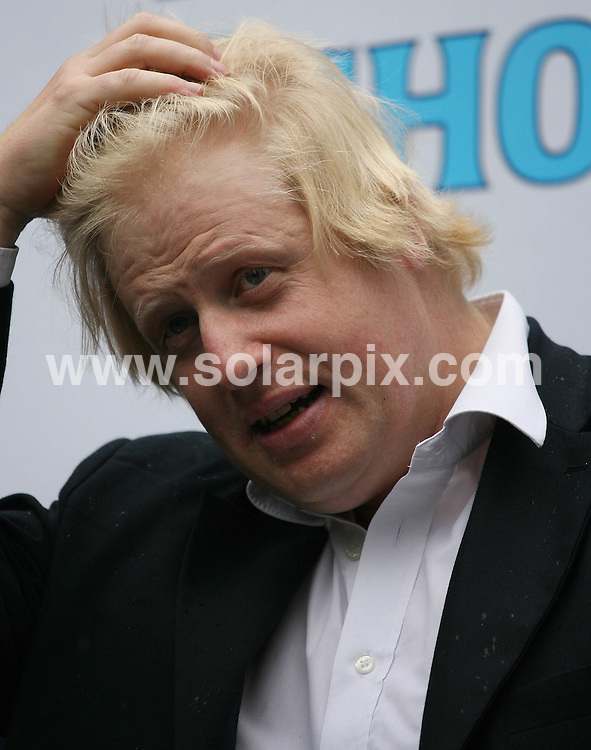 **ALL ROUND PICTURES FROM SOLARPIX.COM**.**WORLDWIDE SYNDICATION RIGHTS**.Rebecca Adlington, Olympic gold medal-winning swimmer is joined by Mayor of London, Boris Johnson to launch a four-week mobile swimming pool on the South Bank of the River Thames in London, which is free to use by members of the public. London, UK. 4 August 2009..This pic: Boris Johnson..JOB REF: 9680 LNJ     DATE: 04_08_2009.**MUST CREDIT SOLARPIX.COM OR DOUBLE FEE WILL BE CHARGED**.**MUST NOTIFY SOLARPIX OF ONLINE USAGE**.**CALL US ON: +34 952 811 768 or LOW RATE FROM UK 0844 617 7637**