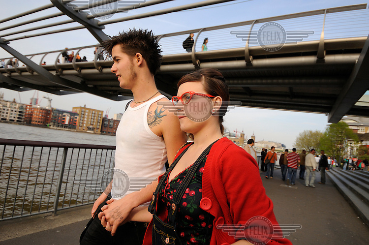 Young London couple by the River Thames.