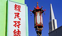 Chinatown with a chinese lamp and the Transamerica Pyramid skyscraper in San Francisco, California, USA
