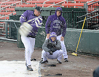 Brant Masters of the Furman Paladins hits a snowball pitch with a shovel after a game against the Northwestern Wildcats was stopped after five innings due to heavy snow on Saturday, February 16, 2013, in Greenville, South Carolina. After a 90-minute delay the game was cancelled. (Tom Priddy/Four Seam Images)