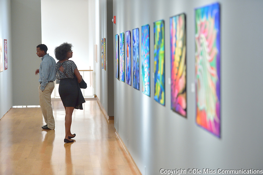 Ryan Watkins and Tiara Mabry check out the award winning, fine art quilts by Caryl Bryer Fallert-Gentry on display in the Mary Buie Museum during a reception held there by Fraternity and Sorority Life welcoming Chancellor and Mrs. Vitter.  Photo by Kevin Bain/Ole Miss Communications