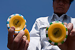 A festival official shows some of the fifteen thousand rubber ducks, each with a number on the base,  that will be emptied in to the Sakawa River during the Ashigara River festival, Kintaro duck-race in Matsuda, Kanagawa, Japan April 25th 2010