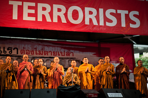Inside the Red Shirt camp at Ratchaprasong, sympathetic monks hold a ceremony for those killed in earlier street fighting.<br /> <br /> From March to May 2010, Red Shirt protestors occupied several sites in Bangkok in an attempt to oust the government, who they believed had come to power illegitimately. <br /> <br /> When the tanks finally rolled in, clearing away the last of the Red Shirts, more than 80 people had been killed and more than 2,000 injured.