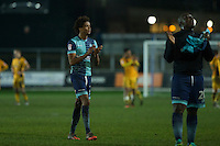 Match winner Sido Jombati of Wycombe Wanderers claps the fans at full time of the Sky Bet League 2 match between Newport County and Wycombe Wanderers at Rodney Parade, Newport, Wales on 22 November 2016. Photo by Mark  Hawkins.