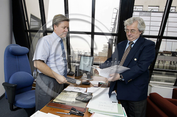 BRUSSELS - BELGIUM - 26 NOVEMBER 2004 -- Einar BULL (R), member of the ESA (EFTA Surveillance Authority) Presidency board, going through documents with Thomas LANGELAND in his office.--PHOTO:  JUHA ROININEN / EUP-IMAGES