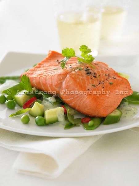 Sockeye salmon fillet with fresh vegetables and yogurt sauce