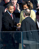 Washington, DC - January 20, 2009 -- United States President Barack Obama, left, shakes hands with United States Chief Justice John Roberts after taking the oath of office as the 44th President of the United States in Washington, DC, USA, 20 January 2009. Obama defeated Republican candidate John McCain on Election Day 04 November 2008 to become the next U.S. President.Credit: Matthew Barrick - CNP