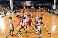 28 January 2012:  FIU guard Fanni Hutlassa (10) battles WKU guard-forward Chasity Gooch (30) and guard-forward LaTeira Owens (31) for a rebound in the first half as the FIU Golden Panthers defeated the Western Kentucky University Hilltoppers, 60-56, at the U.S. Century Bank Arena in Miami, Florida.