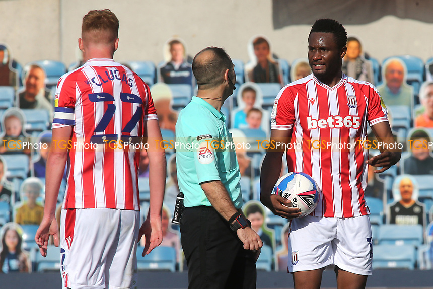 John Obi Mikel of Stoke City and formerly Chelsea has words with referee, Mr Jeremy Simpson during Millwall vs Stoke City, Sky Bet EFL Championship Football at The Den on 12th September 2020
