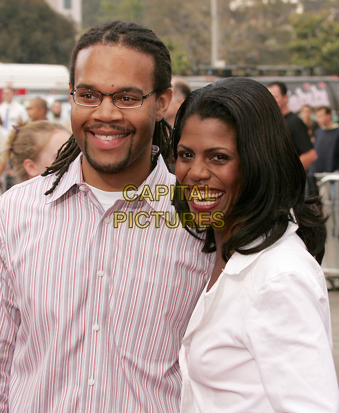 "OMAROSA MANIGAULT-STALLWORTH & HUSBAND.The World Premiere of ""Dodgeball:A True Underdog Story"", Westwood, California.June 14th, 2004.headhsot, portrait, smiling.www.capitalpictures.com.sales@capitalpictures.com.©Capital Pictures"