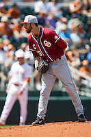 Oklahoma Sooners starting pitcher Dillon Overton #13 looks to his catcher for the sign against the Texas Longhorns in the NCAA baseball game on April 6, 2013 at UFCU DischFalk Field in Austin, Texas. The Longhorns defeated the rival Sooners 1-0. (Andrew Woolley/Four Seam Images).