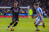 Crystal Palace's midfielder Luka Milivojevic (4) faced up by Huddersfield Town's midfielder Jonathan Hogg (6) during the EPL - Premier League match between Huddersfield Town and Crystal Palace at the John Smith's Stadium, Huddersfield, England on 17 March 2018. Photo by Stephen Buckley / PRiME Media Images.