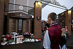A Northampton Town fan taking a photograph on his mobile phone of the Hillsborough memorial outside the Shankly Gates at Anfield, before his team's Carling Cup third round tie away to Liverpool. The visitors from English League 2 defeated Premier League Liverpool on penalty kicks after a 2-2 draw after extra time in one of the biggest shock results in either clubs histories.