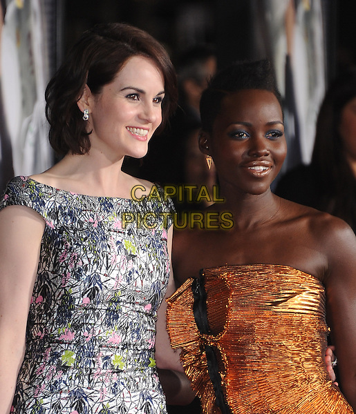 LOS ANGELES, CA - FEBRUARY 24 -Michelle Dockery and Lupita Nyong'o attends Universal Pictures' Non-Stop held at Regency Village Theatre in Westwood, California on February 24,2014                                                                               <br /> CAP/DVS<br /> &copy;DVS/Capital Pictures
