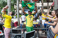 Miami, FL - Friday, July 4, 2014: Colombia and Brazil fans dance during halftime of the Brazil vs. Colombia Quarterfinal World Cup match in the Brickell neighborhood.