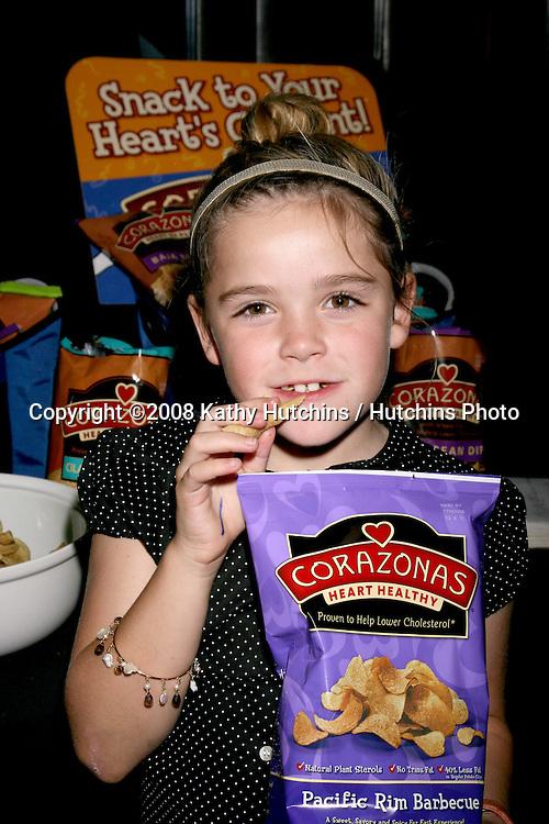 "Kiernan Shipka, of ""Mad Men"".eating Corazonas Chips.GBK Gifting Suite.Thompson Hotel.Beverly Hills, CA.January 11, 2008.©2008 Kathy Hutchins / Hutchins Photo..."
