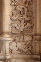 Sculptural detail of a lion with tree growing up the wall, in the arcade of the Cloister, built in Manueline style by Diogo Boitac, Joao de Castilho and Diogo de Torralva, completed 1541, in the Jeronimos Monastery or Hieronymites Monastery, a monastery of the Order of St Jerome, built in the 16th century in Late Gothic Manueline style, Belem, Lisbon, Portugal. The cloister wings have wide arcades with rectangular column and tracery within the arches. The monastery is listed as a UNESCO World Heritage Site. Picture by Manuel Cohen