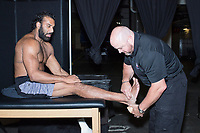 WWE Athletic Trainer Larry Heck tapes up the ankles of current WWE Champion Jinder Mahal before a match as part of the WWE Live Summerslam Heatwave Tour at the MassMutual Center in Springfield, Massachusetts, USA, on Mon., Aug. 14, 2017.