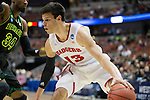 Wisconsin Badgers forward Duje Dukan (13) handles the ball during  a regional semifinal NCAA college basketball tournament game against the Baylor Bears Thursday, March 27, 2014 in Anaheim, California. The Badgers won 69-52. (Photo by David Stluka)