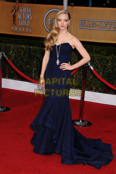 Amanda Seyfried (wearing Zac Posen).Arrivals at the 19th Annual Screen Actors Guild Awards at the Shrine Auditorium in Los Angeles, California, USA..27th January 2013.SAG SAGs full length navy blue fishtail gown dress necklace medallion silver hand on hip strapless   .CAP/ADM/BP.©Byron Purvis/AdMedia/Capital Pictures