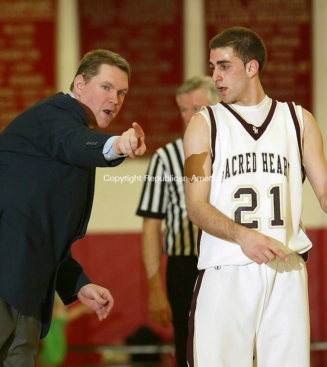 SOUTHBURY, CT, 03/17/09- 031709BZ09- Sacred Heart head coach Jon Carroll talks with Joe Bozutto (21) during their game against Abbott Tech in the Class M semifinals at Pomperaug High School Tuesday night.<br /> Jamison C. Bazinet Republican-American