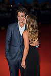 Miles Teller poses with his girlfriend on the red carpet as he arrives for the screening of the premiere of 'The November Man' during the 40th Deauville American Film Festival