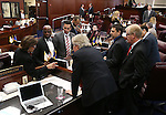 Nevada Senate Secretary Claire Clift, left, talks to Senate Democrats on the Senate floor at the Legislative Building in Carson City, Nev., on Friday, April 3, 2015. <br /> Photo by Cathleen Allison