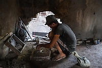 Africa, Madagascar, Ambatolampy village. Men working in aluminum foundry. Maybe one of the most dangerous jobs in Madagascar.