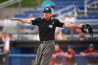 Umpire Donnie Smith signals safe during a game between the Mahoning Valley Scrappers and Batavia Muckdogs on June 22, 2015 at Dwyer Stadium in Batavia, New York.  Mahoning Valley defeated 15-11.  (Mike Janes/Four Seam Images)