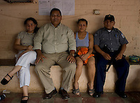 Centro Penal San Miguel, El Salvador, Wednesday, May 16, 2007.  The Warden Licensiado Mersan, a guard and two former gang members.