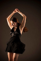 Young woman dancing with motion