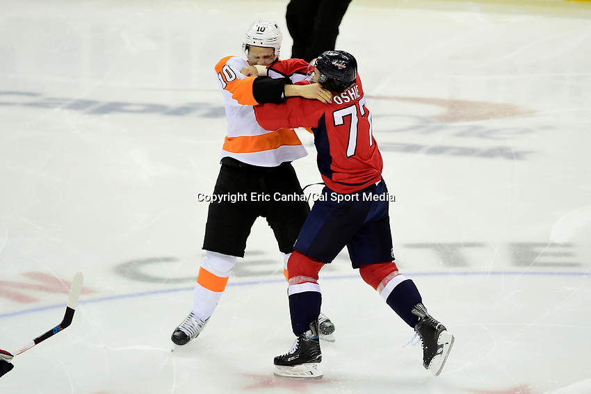 Friday, April 22, 2016: Washington Capitals right wing T.J. Oshie (77) fights with Philadelphia Flyers center Brayden Schenn's (10) during game 5 of the first round of the National Hockey League Eastern Conference playoffs  between the Philadelphia Flyers and the Washington Capitals held at the Verizon Center in Washington, DC. Eric Canha/CSM