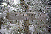 Trail Sign on the summit of Mount Tecumseh in the White Mountains of New Hampshire USA during the winter months.