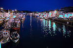 Fishing boats in the harbour at night, Weymouth, Dorset, England