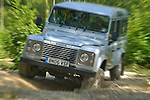 Off roading silver metallic Land Rover Defender 110 TD5 by Land Rover Experience used for driver training. Europe, UK, England. --- No releases available. Automotive trademarks are the property of the trademark holder, authorization may be needed for some uses.